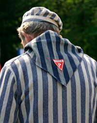 Former polish political prisoner of the Nazi concentration camp in the camping striped uniform